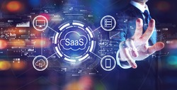 SaaS - software as a service concept with businessman on night city background
