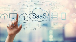 SaaS - software as a service concept with hand pressing a button on a technology screen