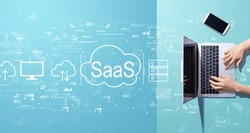SaaS - software as a service concept with person working with a laptop