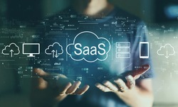 SaaS - software as a service concept with young man in the night