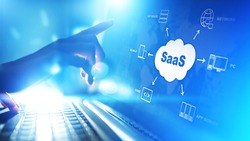 SaaS - Software as a service (on demand). Internet and technology concept on virtual screen.