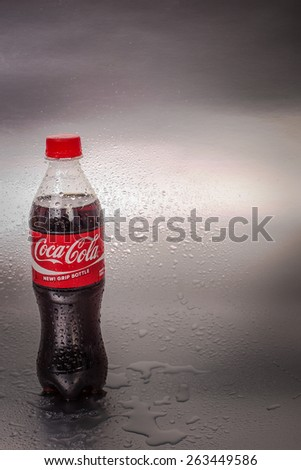 SABAH, MALAYSIA - March 18, 2015: Coca-Cola bottle on metal background.