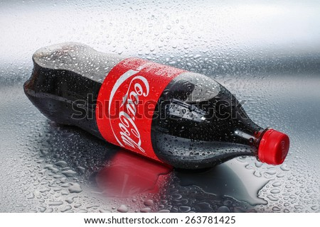 SABAH, MALAYSIA - March 18, 2015: Coca Cola bottle with metal background in wet and cold conditions