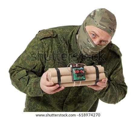 Saboteur in camouflage and a Balaclava helmet with explosives in the hands, isolated on white background #618974270