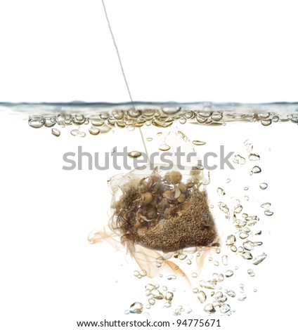 sachet of chamomile dipped in hot water