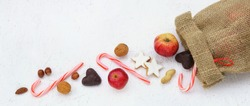 Sack from Santa Claus or Nicholas with apples, nuts and cookies, Copy space