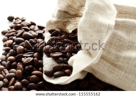 Sack full of coffee beans  over white background