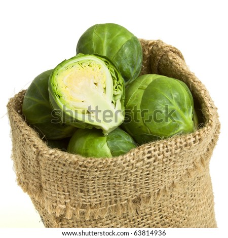 Sack of Brussel Sprouts from low perspective isolated on white.