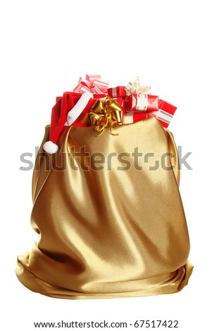 Sack of gold color filled to the brim with Christmas gifts. At one gift Santa's wearing a cap. Isolated on a white background