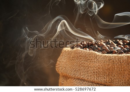Sack with roasted coffee beans on dark background, close up view #528697672