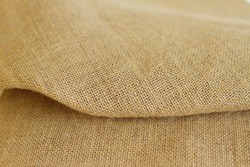 Sackcloth brown textured background, burlap fiber