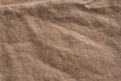Sackcloth burlap woven texture background. Organic linen fabric textile in beige sepia brown color. Close up of material.