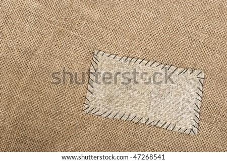 Sackcloth tag on sackcloth material