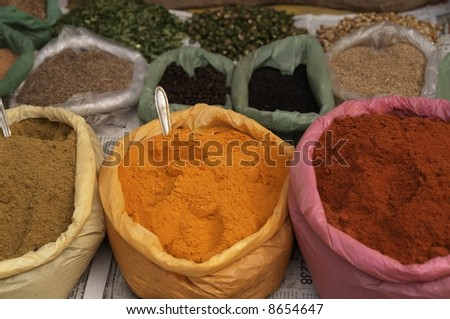Sacks of spices arranged for sale on a market stall in India