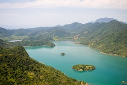 Saco do Mamanguá, located near Paraty, state of Rio de Janeiro, is a narrow long sea area, which goes for 8 km until it reaches a well preserved mangrove forest, with rivers and /Fjord Landscapes/Bag