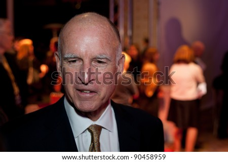 SACRAMENTO, CA - DEC 8: Governor Jerry Brown arrives at the California Hall of Fame ceremonies at the Sacramento Memorial Auditorium in Sacramento, California on December 8, 2011 - stock photo