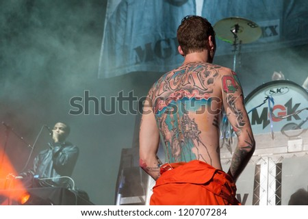 SACRAMENTO, CA - December 1: Machine Gun Kelly performs in Rick Ross MMG Tour featuring Meek Mill and Wale Folarin at Sleep Train Arena in Sacramento, California on December 1, 2012.