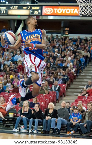 SACRAMENTO, CA - JANUARY 15: Quake Milum with the Harlem Globetrotters goes for the slam dunk at Power Balance Pavilion in Sacramento, California on January 15, 2012