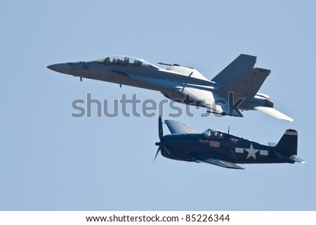 SACRAMENTO, CA - SEPT 10: Grumman F6F Hellcat WW II aircraft and Boeing F/A-18 Super Hornet aircraft during heritage flight at the California Capital Airshow, on September 10, 2011 in Sacramento, CA.
