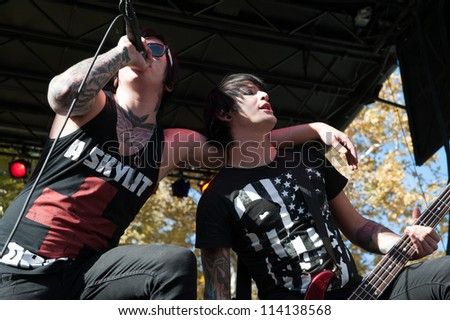 SACRAMENTO, CA - SEPTEMBER 23: Craig Mabbitt (L) and TJ Bell of Escape the Fate performs as part of the Aftershock Music Festival at Discovery Park on September 23, 2012 in Sacramento, California.