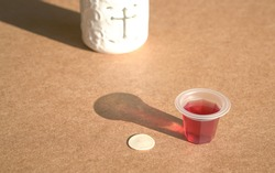Sacraments of bread and cup of wine for Holy Communion or eucharist. Cross symbol at the background.