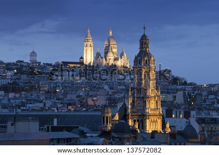 Sacre coeur (Basilica of Sacred heart), Montmartre and Sainte -Trinite at night, Paris, France