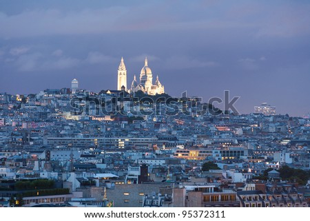 Sacre Coeur viewed from the Eiffel tower at night