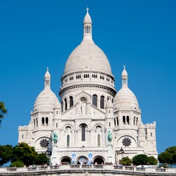 Sacre-Coeur white marble Basilica on highest point of Paris france europe with clear blue sky in background