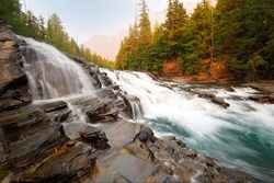 Sacred Dancing Cascade at sunset, Glacier National Park. Sacred Dancing Cascade is a water falls in Glacier National Park and is located in Flathead County in the U.S. state of Montana