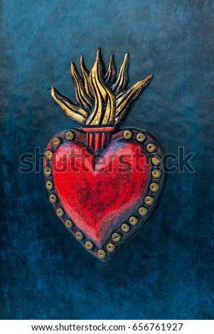 Sacred Heart of Jesus, hand carved and gilded leather detail on the blue book cover - captured close up
