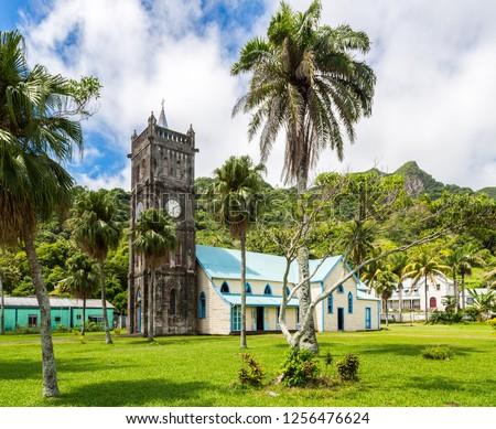 Sacred Heart Roman Catholic Church with a Clock tower. Colourful vibrant old colonial capital of Fiji: Levuka town, Ovalau island, Lomaiviti archipelago, Melanesia, Oceania, South Pacific Ocean.