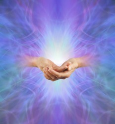 Sacred Purple Ray Healing Energy - female hands  emerging from a purple energy background making cupped hands gesture with a bright light behind and plenty of copy space