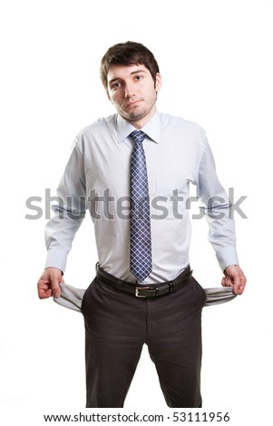Sad and broke business man with empty pockets