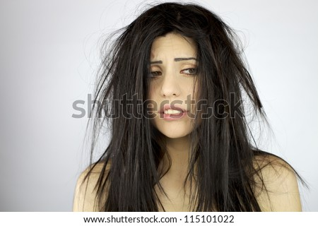 Sad and depressed woman with terrible mess on her hair