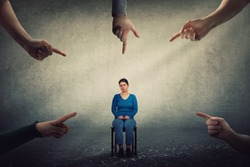 Sad and disappointed woman sitting on a chair looking indisposed being under pressure, feels discomfort as a lot of fingers pointing to her blaming as guilty. Human depression, social victim concept.