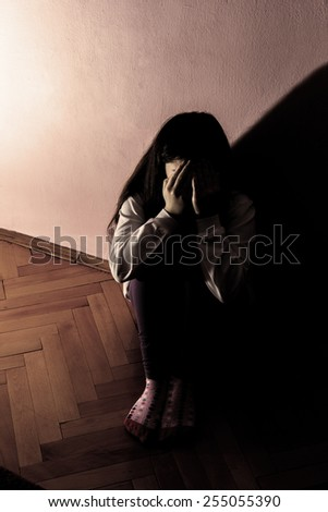 Sad and Lonely Girl Crying with a Hand Covering her Face. Concept: Domestic and Family Violence.