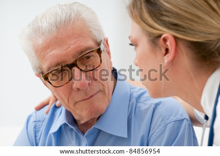 Sad and lonely senior man with nurse