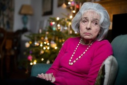Sad And Lonley Senior Woman Unhappy About Spending Christmas At Home Alone