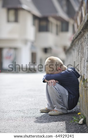 sad and unhappy alone child cry and have emotion problem on street