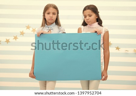 Sad announcement concept. Sorry for bad news. Girl hold advertising banner. Girls kids holding paper banner for announcement. Sad disappointed children with blank paper copy space. #1397952704