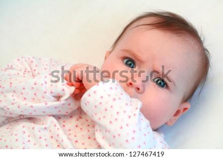 sad baby girl looking at camera close up