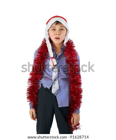 sad beautiful boy in the hat of Santa Claus on a white background