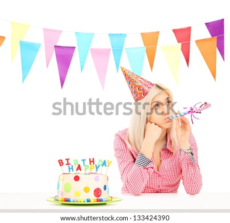 Sad birthday girl with a cake isolated on white background