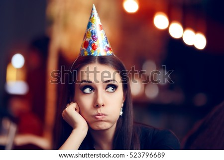 Sad Bored Woman at a Party Having No Fun - Portrait of a funny girl with party hat making faces