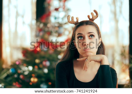 Sad Bored Woman Having No Fun At Christmas Dinner Party - Funny girl wearing reindeer horns headband at Xmas Party