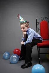 Sad boy alone on his birthday
