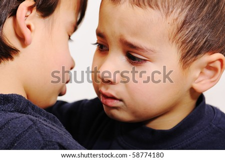 sad boy, brothers, care - stock photo