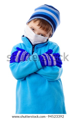 Sad boy in winter clothes and medical mask, isolated on white