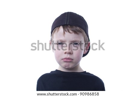 Sad boy looking at camera.  Seamless background.  Room for copy.