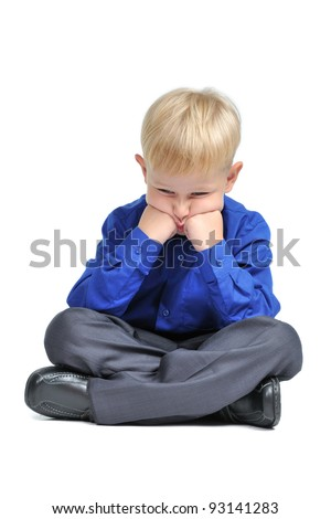 Sad boy with suit sitting in lotus pose isolated